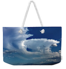 Weekender Tote Bag featuring the photograph Storm Clouds by Chris Tarpening
