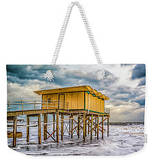 Weekender Tote Bag featuring the photograph Storm Clouds Over The Ocean by Nick Zelinsky