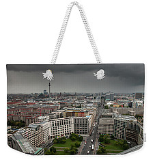 Weekender Tote Bag featuring the photograph Storm Over Berlin by Geoff Smith