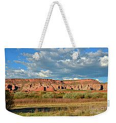 Weekender Tote Bag featuring the photograph Storm Over Red Rocks by Debby Pueschel