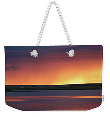 Weekender Tote Bag featuring the photograph Stormclouds After Dark by Heidi Hermes