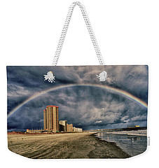 Weekender Tote Bag featuring the photograph Stormy Rainbow by Kelly Reber