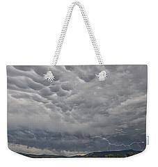 Weekender Tote Bag featuring the photograph Stormy Skies In Wyoming by Sandra Bronstein