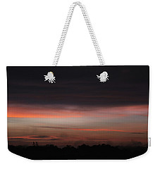 Weekender Tote Bag featuring the photograph Stormy Sunset by Mark Dodd