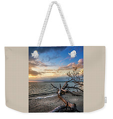 Weekender Tote Bag featuring the photograph Stormy Sunset by Marvin Spates