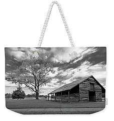 Weekender Tote Bag featuring the photograph Stormy Weather by George Randy Bass