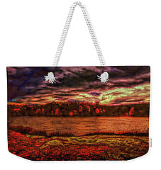 Weekender Tote Bag featuring the photograph Stormy Weather by John M Bailey