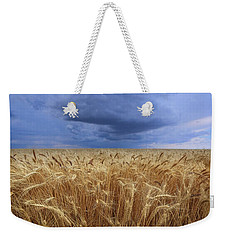 Weekender Tote Bag featuring the photograph Stormy Wheat Field by Lynn Hopwood
