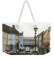 Weekender Tote Bag featuring the photograph Streets Of Cahir by Marie Leslie