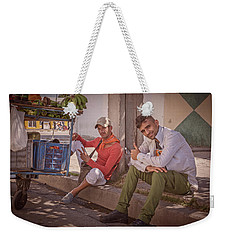 Weekender Tote Bag featuring the photograph Street Vendors In Cienfuegos Cuba by Joan Carroll