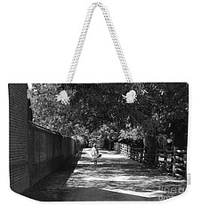Weekender Tote Bag featuring the photograph Stroll To Store by Eric Liller
