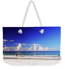 Weekender Tote Bag featuring the photograph Strolling The Beach by Gary Wonning