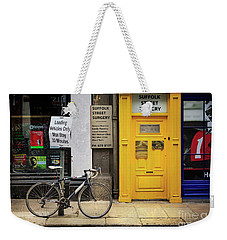 Weekender Tote Bag featuring the photograph Suffolk Street Surgery Bicycle by Craig J Satterlee