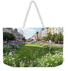 Weekender Tote Bag featuring the photograph Summer Prague by Jenny Rainbow
