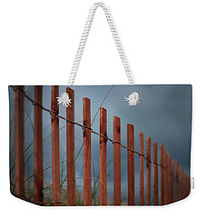 Weekender Tote Bag featuring the photograph Summer Storm Beach Fence by Laura Fasulo