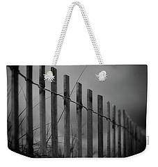 Weekender Tote Bag featuring the photograph Summer Storm Beach Fence Mono by Laura Fasulo