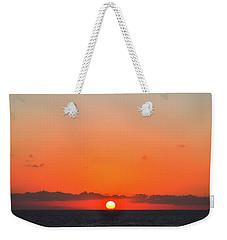 Sun Balancing On The Horizon Weekender Tote Bag