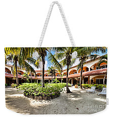 Weekender Tote Bag featuring the photograph Sun Breeze Hotel by Lawrence Burry