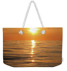 Sun Setting Over Calm Waters Weekender Tote Bag