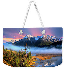 Weekender Tote Bag featuring the photograph Sundance by John Poon