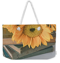 Weekender Tote Bag featuring the photograph Sunflowers And Books by Kim Hojnacki