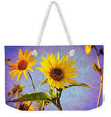 Weekender Tote Bag featuring the photograph Sunflowers - The Arrival by Glenn McCarthy Art and Photography