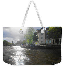 Weekender Tote Bag featuring the photograph Sunlight On Canal In Amsterdam by Therese Alcorn