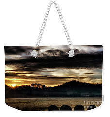 Weekender Tote Bag featuring the photograph Sunrise And Hay Bales by Thomas R Fletcher