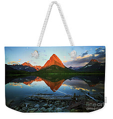 Weekender Tote Bag featuring the photograph Sunrise At Many Glaciers by Craig J Satterlee