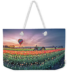 Weekender Tote Bag featuring the photograph Sunrise, Hot Air Balloon And Moon Over The Tulip Field by William Lee