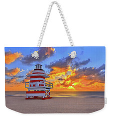 Weekender Tote Bag featuring the photograph Sunrise Over Lifegaurd Stand On South Miami Beach  by Justin Kelefas