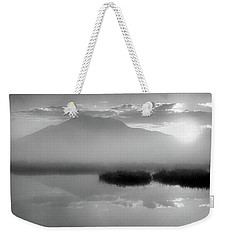 Weekender Tote Bag featuring the photograph Sunrise by Tatsuya Atarashi