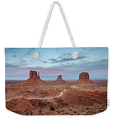 Weekender Tote Bag featuring the photograph Sunset At Monument Valley No.1 by Margaret Pitcher