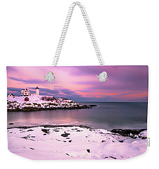 Weekender Tote Bag featuring the photograph Sunset At Nubble Lighthouse In Maine In Winter Snow by Ranjay Mitra