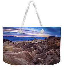 Weekender Tote Bag featuring the photograph Sunset At Zabriskie Point In Death Valley National Park by John Hight