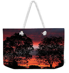 Sunset Behind Two Trees Weekender Tote Bag