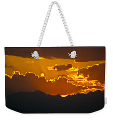 Weekender Tote Bag featuring the photograph Sunset Fire by Colleen Coccia