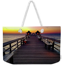 Weekender Tote Bag featuring the photograph Sunset On The Pier by TK Goforth