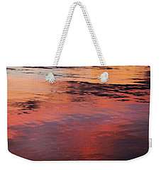 Weekender Tote Bag featuring the photograph Sunset On Water by Theresa Tahara