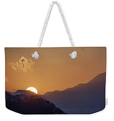 Weekender Tote Bag featuring the photograph Sunset Over Asia  by Rikk Flohr