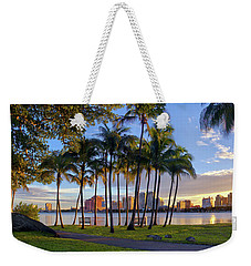 Weekender Tote Bag featuring the photograph Sunset Over Downtown West Palm Beach From Palm Beach Island by Justin Kelefas