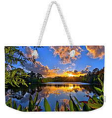 Weekender Tote Bag featuring the photograph Sunset Over Hidden Lake In Jupiter Florida by Justin Kelefas