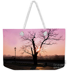 Weekender Tote Bag featuring the photograph Sunset Over Krakow by Juli Scalzi