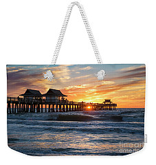 Weekender Tote Bag featuring the photograph Sunset Over Naples Pier by Brian Jannsen