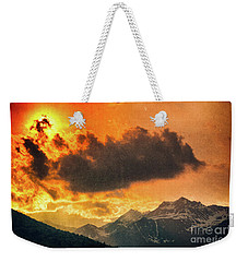 Weekender Tote Bag featuring the photograph Sunset Over The Alps by Silvia Ganora
