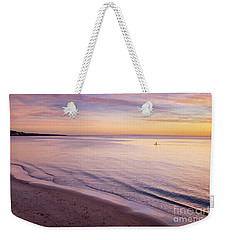 Weekender Tote Bag featuring the photograph Sunset Paddle by Ray Warren