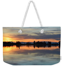 Weekender Tote Bag featuring the photograph Sunset Reflections by AJ Schibig