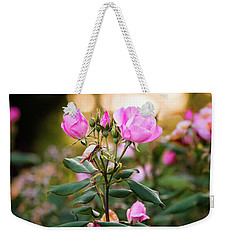 Weekender Tote Bag featuring the photograph Sunset Roses by Parker Cunningham