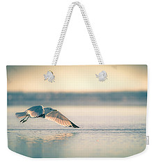 Weekender Tote Bag featuring the photograph Sunset Seagull Takeoffs by T Brian Jones