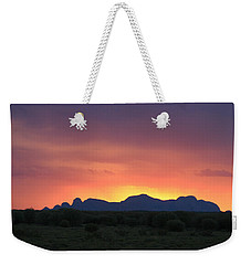 Weekender Tote Bag featuring the photograph Sunset Silhouette Of Kata Tjuta In The Northern Territory by Keiran Lusk